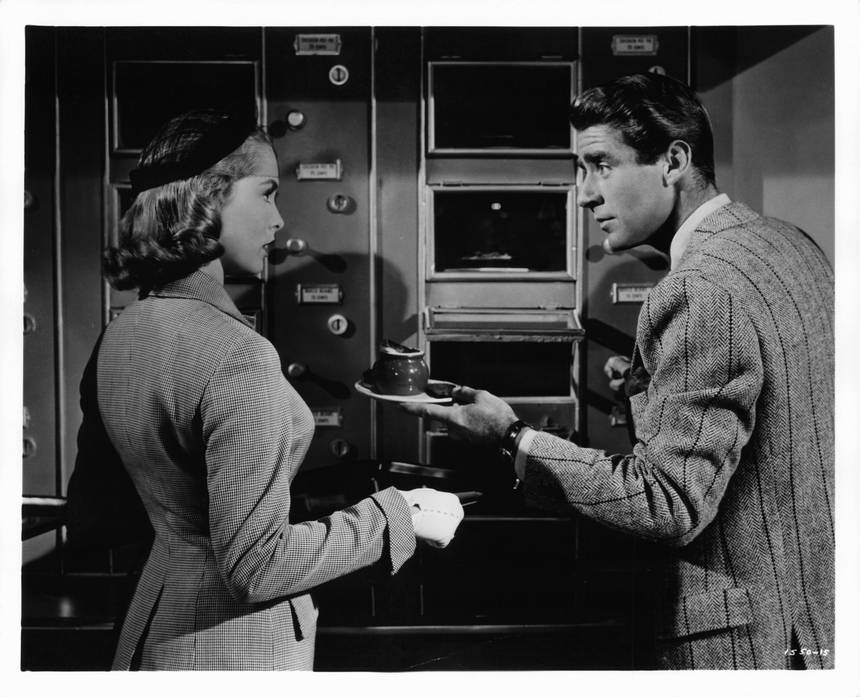 Janet Leigh makes Peter Lawford learn to eat from automat